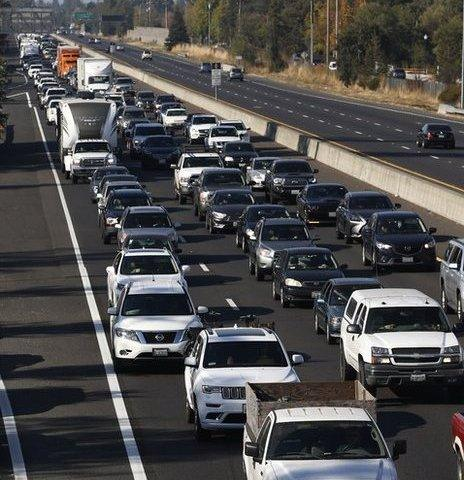 Vehicles travel south along Highway 101 as residents evacuate towns and cities in anticipation of the expected wind event on October 26, 2019 in Windsor, California