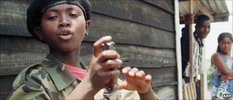 A child soldier in the Democratic Republic of Congo in 1998