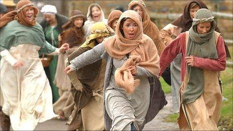 Women fleeing during a re-enactment of a 15th Century battle in Wales