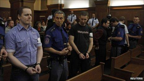 Right wing extremists David Vaculik (L to R), Jaromir Lukes, Ivo Mueller and Vaclav Cojocaru in court in Ostrava where they were convicted of an arson attack