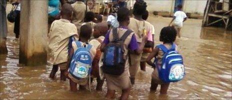 Children wading to school in Avotrou, Cotonou