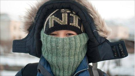 Artyom, 10, on his way home from school