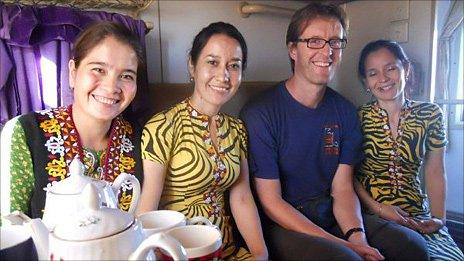 The author with new friends on a train in Turkmenistan