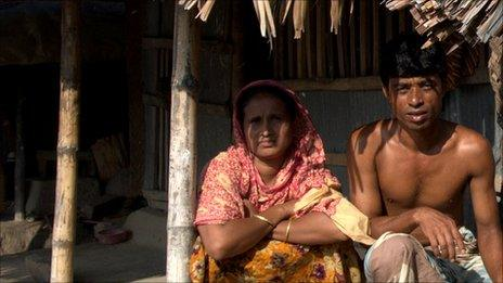 Mujib and his wife in front of their new home