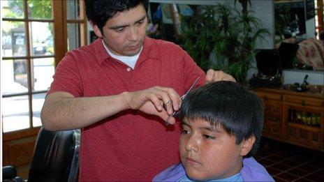 Ricardo Hernandez cuts hair in Santiago