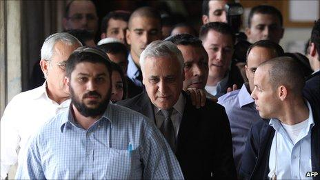 Moshe Katsav leaves court after hearing the verdict in his trial for rape