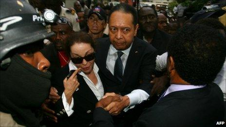 """Former Haitian president Jean-Claude """"Baby Doc"""" Duvalier and his wife Veronique Roy depart court on 18 January 2011"""