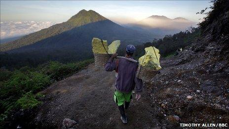 The workers carry loads of up to 90kg of sulphur mined from the volcano