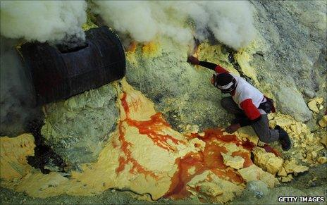 Sulphur mining in the volcano crater