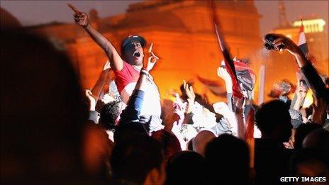 Anti-government demonstrators celebrate in Tahrir Square upon hearing the news of the resignation of Egyptian President Hosni Mubarak on February 11, 2011 in Cairo, Egypt