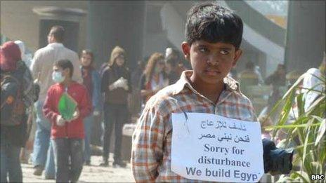 Boy with sign, Tahrir Square, Cairo (12 February 2011)