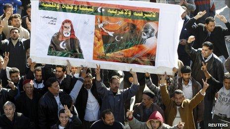 Libyan protesters hold a poster of Omar Mukhtar in Zawiyah, 1 March