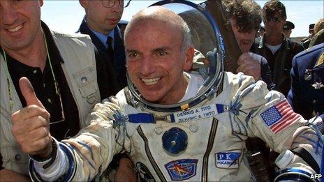 US space tourist Dennis Tito celebrates after his landing near the town of Arkalyk in Kazakhstan on 6 May 2001
