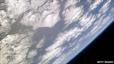 A blue and white part of Earth against the blackness of space. Photo taken from the space shuttle Atlantis in May 2010