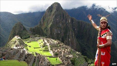 A man dressed in a typical Inca attire participates in a practice session atop of the Inca citadel of Machu Picchu on 19 April, 2011