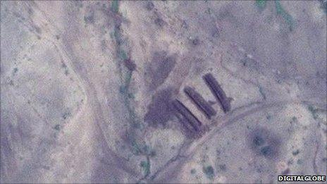 Images of Mass graves in Sudan discovered by George Clooney's Satellite Monitoring Project.