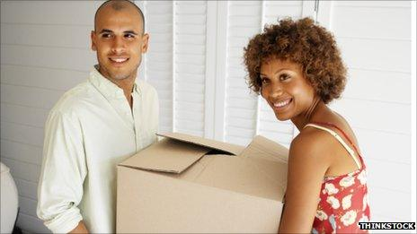 Man and woman with box