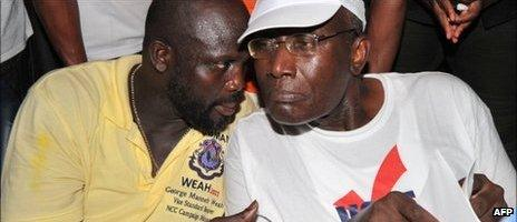 George Weah (l) and Winston Tubman on 7 October