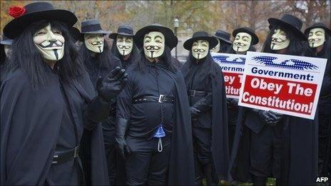 Protesters with 'We the People Foundation for Constitutional Education' dress in the costume of V in November 2006 in Washington, DC