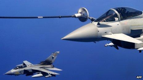 A British Tornado jet and Eurofighter refuel above the Mediterranean sea