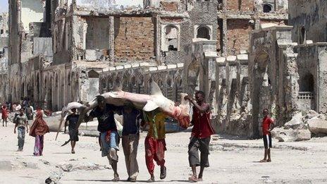 Somali men carrying a fish in Mogadishu (November 2011)