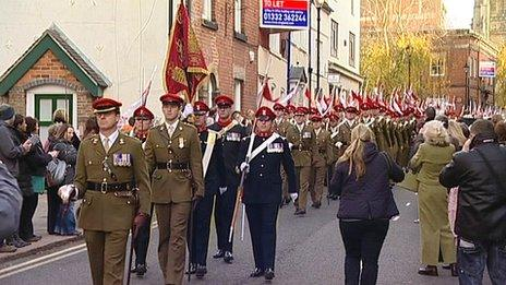 The 9th/12th Royal Lancers march through Derby city centre