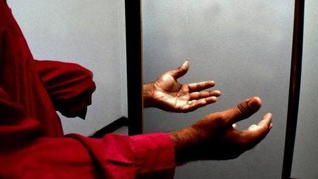 An amputee doing mirror therapy