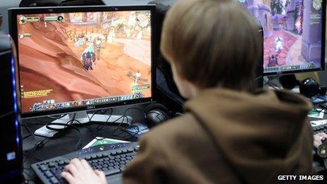 A boy plays World of Warcraft
