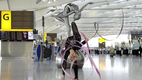 Frankie Jones and the sculpture at Heathrow