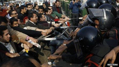 Anti-government protesters clash with police in downtown Cairo January 25, 2011.