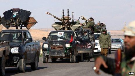 Libya's former rebels gather at a checkpoint near a mosque, outside Bani Walid on January 2012