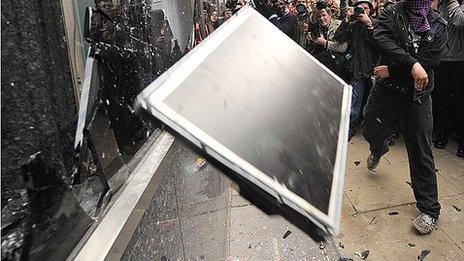 Computer screen being thrown through window