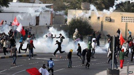 Riot police fire tear gas to disperse anti-government protesters on a road near Manama (13 February 2012)