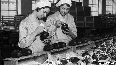 Two women at Cadbury's chocolate factory in Bournville, in the West Midlands join together chocolate Easter egg halves in 1932. Photo: Getty Images