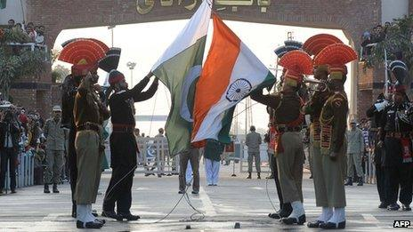 Pakistani Rangers (in black) and Indian Border Security Force (BSF) personnel (in brown) perform the daily retreat ceremony on the India-Pakistan Border at Wagah - 8 January 2012