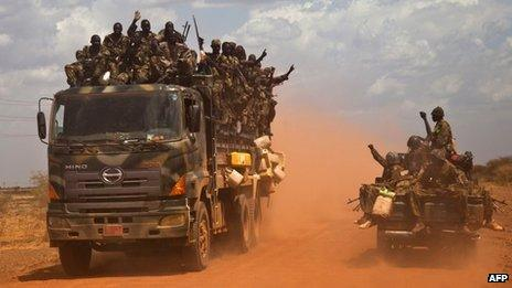 SPLA (South Sudan People's Liberation Army) vehicles drive on the road from Bentiu to Heglig, on April 17, 2012