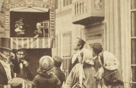 Photograph portraying a Punch and Toby puppet show dated 1860s. George Speaight Punch & Judy Collection. (Photo from V&A Museum of Childhood)