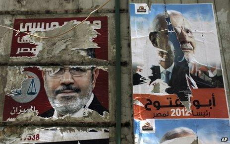 Defaced posters for Islamist presidential candidates Mohammed Mursi and Abdul Moneim Aboul Fotouh (7 May 2012)