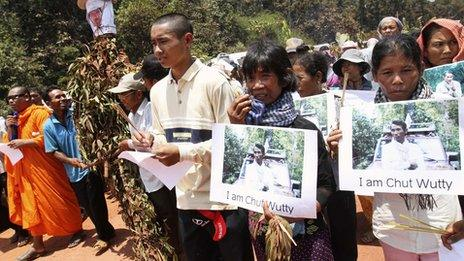 People march to the site where Cambodian anti-logging activist Chut Wutty was killed