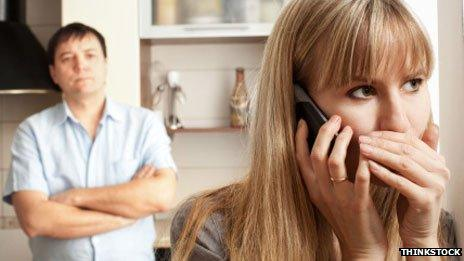 Woman secretly talking on phone