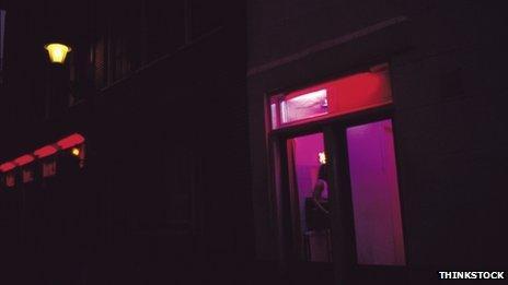 A prostitute in a window