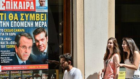 Athens street with magazine ad showing political leaders, 21 Jun 12