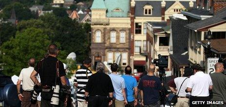 People try to get a glimpse of the jury arriving for the Jerry Sandusky child sex abuse trial at the court on 22 June 2012 in Bellefonte, Pennsylvania