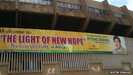 A Happy Science poster at Namboole Stadium in Kampala