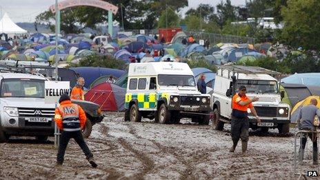 Ambulance being towed through the mud at the Isle of Wight Festival