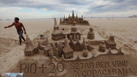 A Rio+20 sand sculpture is seen on Copacabana beach on the final day of the UN conference on 22 June 2012 in Rio de Janeiro