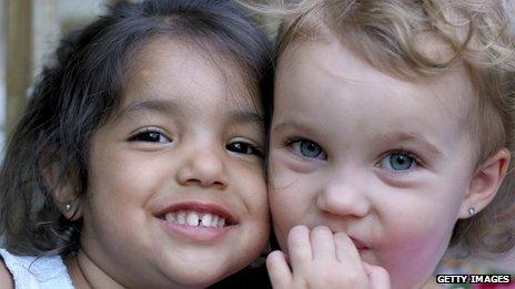 Two children wearing earrings