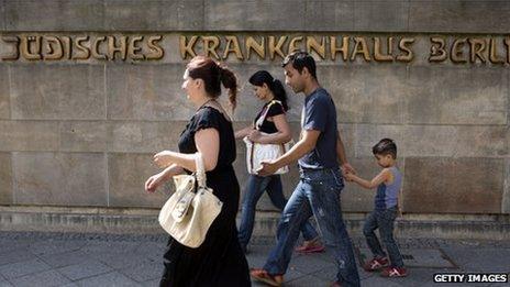 People walking past the Jewish Hospital in Berlin