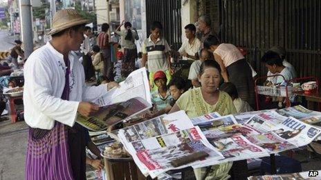 A man buys a weekly news journal at a roadside newspaper stand in Rangoon, Burma, 10 June, 2012