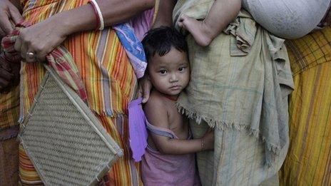 An ethnic violence affected child looks on at a relief camp at Bhot Gaon village in Kokrajhar, Assam state, India, Wednesday, July 25, 2012.